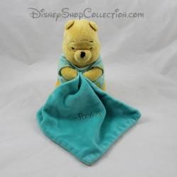 Doudou Winnie the BEAR DISNEY NICOTOY blue green handkerchief shines in the phosphorescent night