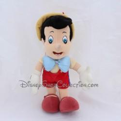 Peluche articulée Pinocchio DISNEYLAND PARIS petit garçon pantin de bois Disney 34 cm