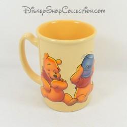 Mug en relief Winnie l'ourson DISNEY STORE différentes expressions tasse céramique orange 3D