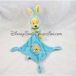 Doudou Winnie l'ourson NICOTOY déguisé en lapin bleu avec mouchoir Disney