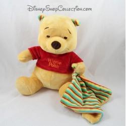 Peluche Winnie l'ourson NICOTOY couverture rayée jaune vert rouge bleu